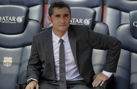 FC Barcelona's new signing coach Ernesto Valverde poses to the media during his official presentation at the Camp Nou stadium in Barcelona, Spain, Thursday, June 1, 2017. Former player Valverde was hired as the new coach, the club confirmed on Monday. (AP Photo/Manu Fernandez)