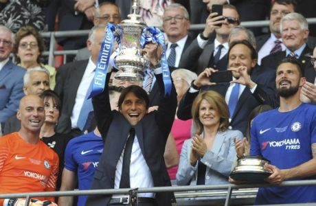 Chelsea head coach Antonio Conte lifts the trophy after winning the English FA Cup final soccer match between Chelsea and Manchester United at Wembley stadium in London, Saturday, May 19, 2018. Chelsea defeated Manchester United 1-0. (AP Photo/Rui Vieira)