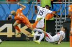 Netherlands' Arjen Robben is sent flying by a challenge from Costa Rica's Junior Diaz, center, and Michael Umana, right, during the World Cup quarterfinal soccer match between the Netherlands and Costa Rica at the Arena Fonte Nova in Salvador, Brazil, Saturday, July 5, 2014. (AP Photo/Matt Dunham)
