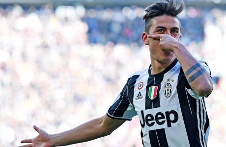epa05741299 Juventus' Paulo Dybala jubilates after scoring a goal during the Italian Serie A soccer match Juventus vs Lazio at Juventus Stadium in Turin, Italy, 22 January 2017  EPA/ALESSANDRO DI MARCO