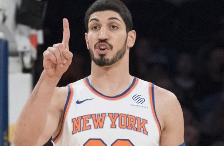 New York Knicks center Enes Kanter gestures during the first half of an NBA basketball game against the Milwaukee Bucks, Tuesday, Feb. 6, 2018, at Madison Square Garden in New York. (AP Photo/Mary Altaffer)