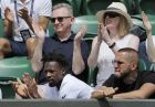 Gael Monfils of France, bottom left, watches as Ukraine's Elina Svitolina plays Maria Sakkari of Greece in a Women's singles match during day five of the Wimbledon Tennis Championships in London, Friday, July 5, 2019. (AP Photo/Ben Curtis)
