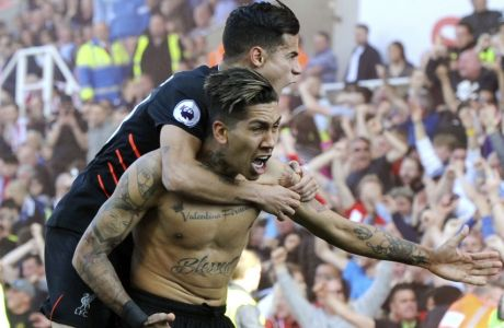 Liverpool's Roberto Firmino, right, celebrates after scoring his team's second goal of the game during the English Premier League soccer match between Stoke City and Liverpool at the Britannia Stadium, Stoke on Trent, England, Saturday, March. 18, 2017. (AP Photo/Rui Vieira)