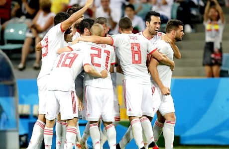 Spain's team celebrates Nacho, right, after he scored his side's third goal during the group B match between Portugal and Spain at the 2018 soccer World Cup in the Fisht Stadium in Sochi, Russia, Friday, June 15, 2018. (AP Photo/Frank Augstein)
