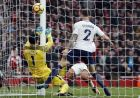 Tottenham's goalkeeper Hugo Lloris fails to save the shot from Arsenal's Alexis Sanchez during the English Premier League soccer match between Arsenal and Tottenham Hotspur at Emirates stadium in London, Saturday, Nov. 18, 2017. (AP Photo/Kirsty Wigglesworth)