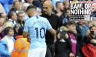 Manchester City's Sergio Aguero, left, reacts with Manchester City manager Josep Guardiola after being substituted by Manchester City's Gabriel Jesus during the English Premier League soccer match between Manchester City and Fulham at Etihad stadium in Manchester, England, Saturday, Sept. 15, 2018. (AP Photo/Rui Vieira)