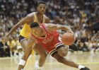 Chicago Bulls Scottie Pippen supports himself with his arm as he drives around Los Angeles Lakers A.C. Green during first half action of game five in the NBA finals at the Forum in Inglewood, Calif., on Wednesday, June 12, 1991. (AP Photo/Bob Galbraith)