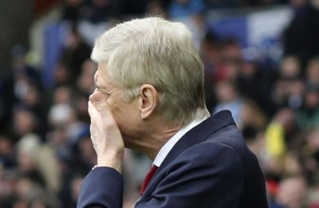 Arsenal manager Arsene Wenger gestures during the English Premier League soccer match between Brighton and Arsenal at the AMEX Stadium, in Brighton, England, Sunday March 4, 2018. (Gareth Fuller/PA via AP)