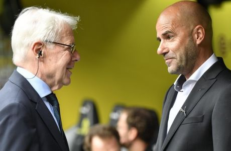 Dortmund's new head coach Peter Bosz, right, talks with BVB president Reinhard Rauball prior the German Bundesliga soccer match between Borussia Dortmund and Hertha BSC Berlin in Dortmund, Germany, Saturday, Aug. 26, 2017. (AP Photo/Martin Meissner)