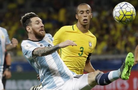 Argentina's Lionel Messi plays the ball under the watch of Brazil's Miranda, center back, during a 2018 World Cup qualifying soccer match at the Mineirao stadium in Belo Horizonte, Brazil, Thursday Nov. 10, 2016.(AP Photo/Andre Penner)