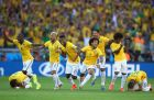 BELO HORIZONTE, BRAZIL - JUNE 28:  Brazil celebrate after defeating Chile in a penalty shootout during the 2014 FIFA World Cup Brazil round of 16 match between Brazil and Chile at Estadio Mineirao on June 28, 2014 in Belo Horizonte, Brazil.  (Photo by Paul Gilham/Getty Images)