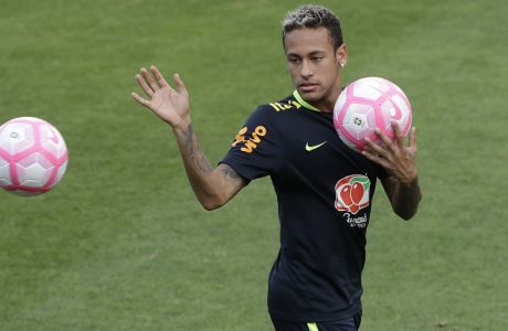 Brazil's Neymar attends a training session in preparation for an upcoming World Cup qualifying match, in Sao Paulo, Brazil, Friday, Oct. 6, 2017.  (AP Photo/Andre Penner)