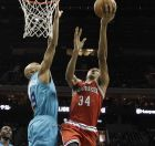 Milwaukee Bucks' Giannis Antetokounmpo (34) shoots over Charlotte Hornets' Gerald Henderson (9) during the first half of an NBA basketball game in Charlotte, N.C., Wednesday, Oct. 29, 2014. (AP Photo/Chuck Burton)