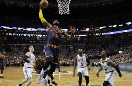 Cleveland Cavaliers forward LeBron James (23) soars to the basket over Boston Celtics forward Jonas Jerebko (8) forward Jaylen Brown (7) and guard Terry Rozier (12) during the first half of Game 5 of the NBA basketball Eastern Conference finals, on Thursday, May 25, 2017, in Boston. (AP Photo/Charles Krupa)