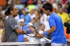 Novak Djokovic, of Serbia, right, shakes hands with Marcos Baghdatis, of Cyprus,, after Djokovic won their match at the BNP Paribas Open tennis tournament, Saturday, March 14, 2015, in Indian Wells, Calif. (AP Photo/Mark J. Terrill)