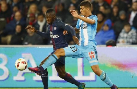 PSG's Blaise Matuidi, left, challenges for the ball with Marseille's Zinedine Machach during their French League One soccer match between PSG and Marseille at the Parc des Princes stadium in Paris, France, Sunday, Oct. 23, 2016. (AP Photo/Francois Mori)