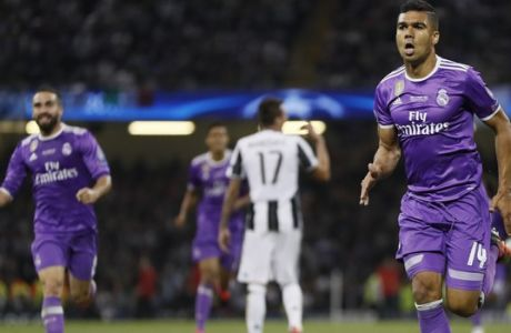 Real Madrid's Casemiro celebrates after scoring during the Champions League final soccer match between Juventus and Real Madrid at the Millennium Stadium in Cardiff, Wales, Saturday June 3, 2017. (AP Photo/Kirsty Wigglesworth)