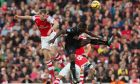 Arsenals Per Mertesacker, left, competes for the ball with Burnleys Marvin Sordell during their English Premier League soccer match at the Emirates stadium, London, Saturday, Nov. 1, 2014. (AP Photo/Tim Ireland)