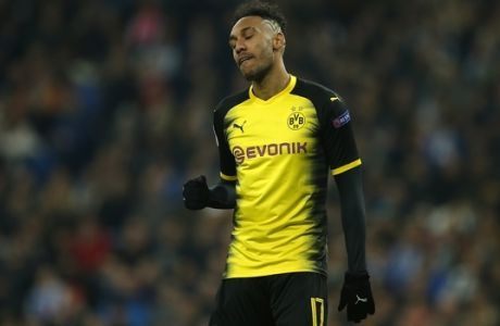 Dortmund's Pierre-Emerick Aubameyang makes a fist with closed eyes after he scored his second goal during the Champions League Group H soccer match between Real Madrid and Borussia Dortmund at the Santiago Bernabeu stadium in Madrid, Spain, Wednesday, Dec. 6, 2017. (AP Photo/Paul White)