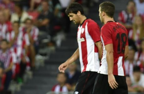 Real Madrid 's Marcelo Vieira lies on the pitch beside Oscar de Marcos after missing a goal against Athletic Bilbao during the Spanish La Liga soccer match between Athletic Bilbao and Real Madrid at San Mames stadium, in Bilbao, northern Spain, Saturday, Sept. 15, 2018. (AP Photo/Alvaro Barrientos)