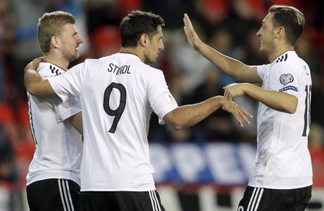 From left, Germany's scorer Timo Werner and his teammates Lars Stindl and Mesut Ozil celebrate the opening goal during the World Cup Group C qualifying soccer match between Czech Republic and Germany in Prague, Czech Republic, Friday, Sept. 1, 2017. (AP Photo/Petr David Josek)
