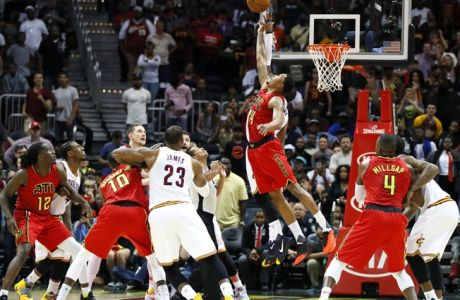 Atlanta Hawks forward Kent Bazemore (24) goes up for the jump ball in the final seconds of the second half of an NBA basketball game against the Cleveland Cavaliers on Sunday, April 9, 2017, in Atlanta. The Hawks won in overtime 126-125. (AP Photo/Todd Kirkland)