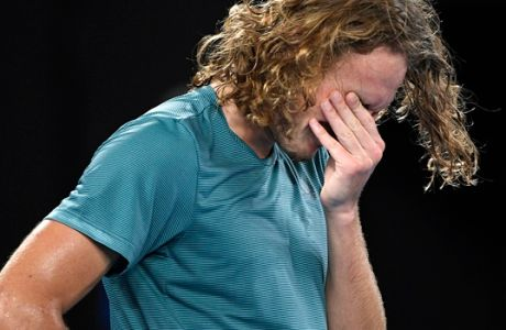 Greece's Stefanos Tsitsipas reacts after defeating Switzerland's Roger Federer in their fourth round match at the Australian Open tennis championships in Melbourne, Australia, Sunday, Jan. 20, 2019. (AP Photo/Andy Brownbill)