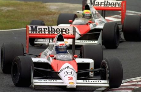 French Alain Prost, in McLaren-Honda, is chased by Brazilian teammate Ayrton Senna during Sunday's Formula One Japan Grand Prix at Suzuka Circuit, Oct. 22, 1989.  These cars crashed in this chicane later in the race. (AP Photo/Tsugufumi Matsumoto)