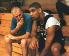 San Antonio Spurs coach Greg Popovich, left, chats with his center Tim Duncan during a visit to the U.S. Olympic practice at the Orlando Magic training facility in Orlando, Fla., Thursday, July 8, 1999. Officials hope the latest U.S. national basketball squad _ Dream Team IV _ will bring back the joy of the original edition and keep its international winning streak growing.(AP Photo/Peter Cosgrove)