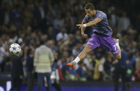 Real Madrid's Cristiano Ronaldo warms up during the Champions League final soccer match between Juventus and Real Madrid at the Millennium Stadium in Cardiff, Wales, Saturday June 3, 2017. (AP Photo/Tim Ireland)
