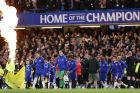 Chelsea's English defender John Terry (2L) leads his team out for the English Premier League football match between Chelsea and Watford at Stamford Bridge in London on May 15, 2017. / AFP PHOTO / Adrian DENNIS / RESTRICTED TO EDITORIAL USE. No use with unauthorized audio, video, data, fixture lists, club/league logos or 'live' services. Online in-match use limited to 75 images, no video emulation. No use in betting, games or single club/league/player publications.  /