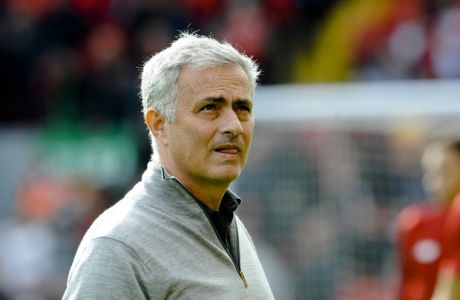 Manchester United coach Jose Mourinho arrives on the pitch for the English Premier League soccer match between Liverpool and Manchester United at Anfield, Liverpool, England, Saturday, Oct. 14, 2017. (AP Photo/Rui Vieira)