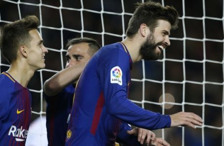 FC Barcelona's Gerard Pique, right, celebrates with his teammates after scoring during a Spanish Copa del Rey round of 32 second leg soccer match between FC Barcelona and Murcia at the Camp Nou stadium in Barcelona, Wednesday, Nov 29, 2017. (AP Photo/Manu Fernandez)