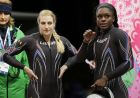 The team from the United States USA-2, piloted by Jamie Greubel, left, with brakeman Aja Evans, react after their third run during the women's bobsled competition at the 2014 Winter Olympics, Wednesday, Feb. 19, 2014, in Krasnaya Polyana, Russia. (AP Photo/Jae C. Hong)