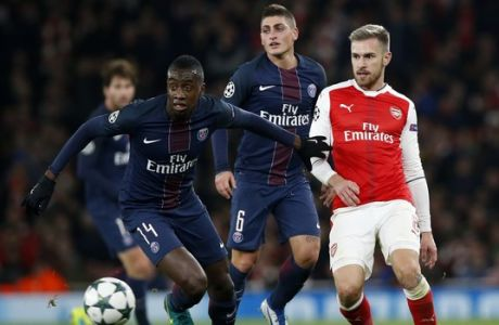 PSG's Blaise Matuidi battles for the ball with Arsenal's Aaron Ramsey, right, during the Champions League group A soccer match between Arsenal and Paris Saint Germain at the Emirates stadium in London, Wednesday, Nov. 23, 2016. (AP Photo/Alastair Grant)