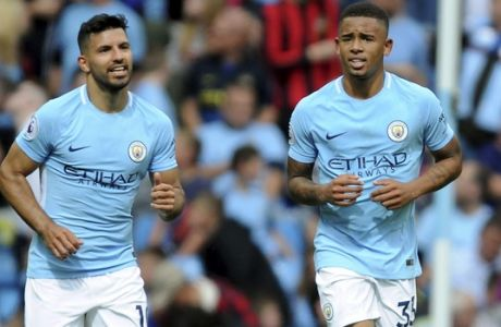 Manchester City's Gabriel Jesus, right, celebrates after scoring his side's 2nd goal during the English Premier League soccer match between Manchester City and Liverpool at the Etihad Stadium in Manchester, England, Saturday, Sept. 9, 2017. (AP Photo/Rui Vieira)