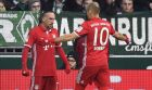 Bayern's Arjen Robben, right, celebrates after scoring the opening goal with assistant Franck Ribery, left, during the German Bundesliga soccer match between Werder Bremen and Bayern Munich in Bremen, Saturday, Jan. 28, 2017. (AP Photo/Martin Meissner)