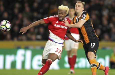 Middlesbrough's Adama Traore, left, and Hull City's Kamil Grosicki chase the ball during the English Premier League soccer match at the KCOM Stadium in Hull, England, Wednesday April 5, 2017. (Richard Sellers/PA via AP)
