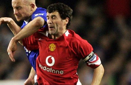 Everton's Lee Carsley, rear,  jumps up with Manchester United's Roy Keane during their FA Cup soccer match at Goodison Park, Liverpool, England, Saturday, Feb. 19, 2005. (AP Photo/Paul Ellis)