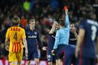 Atletico's Fernando Torres, 2nd left is shown a red card by Referee Felix Brych during a Champions League quarter-final, first leg soccer match between FC Barcelona and Atletico Madrid at the Camp Nou stadium in Barcelona, Spain, Tuesday April 5, 2016. (AP Photo/Manu Fernandez)