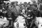 The winners congratulate each other after the Lightweight 250 cc International 226.4 mile motorcycle race over the Tourist Trophy Mountain Circuit on the Isle of Man on June 14, 1965. From left: Frank Perris who finished third riding a Suzuki; Mike Duff, who placed second on a Yamaha and former World Champion Jim Redman who won on a Honda for the third year running. The boy with Duff is his son. (AP Photo)