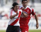 River Plate's Ariel Ortega, left, fights for the ball with Huracan's Marcos Britez Ojeda at an Argentine soccer league match in Buenos Aires, Argentina, Sunday Aug. 15, 2010. (AP Photo/Natacha Pisarenko)