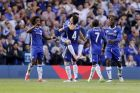 Chelsea's Pedro is held up by Cesc Fabregas as he celebrates scoring his side's third goal during the English Premier League soccer match between Chelsea and Sunderland at Stamford Bridge stadium in London, Sunday, May 21, 2017. (AP Photo/Frank Augstein)