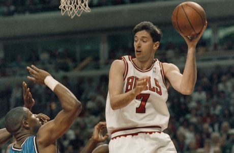 The Chicago Bulls' Toni Kukoc looks to pass off around Orlando Magic's Nick Anderson during the first quarter of their second-round Playoff Game in Chicago, Sunday, May 14, 1994. The Bulls beat the Magic 106-95 to even the series at two games apiece. (AP Photo/Fred Jewell)