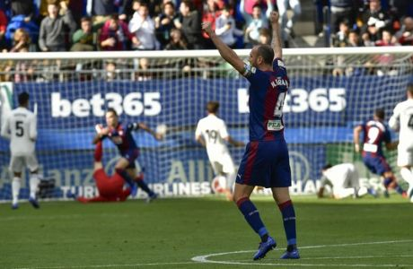 Deportivo SD Eibar's Ivan Ramis celebrates a goal after scoring his team's first goal against Real Madrid during the Spanish La Liga soccer match between Real Madrid and SD Eibar at Ipurua stadium, in Eibar, northern Spain, Saturday, Nov. 24, 2018. (AP Photo/Alvaro Barrientos)