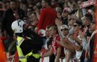 A police officer watches Cologne supporters during the Europa League group H soccer match between Arsenal and FC Cologne at the Emirates stadium in London, England, Thursday, Sept. 14, 2017 . (AP Photo/Kirsty Wigglesworth)