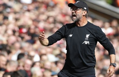 Liverpool's manager Jurgen Klopp shouts during the English Premier League soccer match between Liverpool and Newcastle at Anfield stadium in Liverpool, England, Saturday, Sept. 14, 2019. (AP Photo/Rui Vieira)