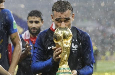 France's Antoine Griezmann kisses the trophy after the final match between France and Croatia at the 2018 soccer World Cup in the Luzhniki Stadium in Moscow, Russia, Sunday, July 15, 2018. (AP Photo/Matthias Schrader)