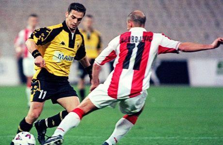 Ο Ντέμης Νικολαΐδης με αντίπαλο τον Πρέντραγκ Τζόρτζεβιτς σε ντέρμπι της ΑΕΚ με τον Ολυμπιακό