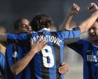 InterMilan's Zlatan Ibrahimovic of Sweden, center, celebrates after scoring the second goal with his teammates Leite Ribeiro Adriano of Brazil, left, and Dejan Stankovic of Serbia during an Italian major league soccer match between Ascoli and Inter Milan at the Cino e Lillo Del Duca stadium in Ascoli Piceno, Italy, Sunday, March 18, 2007. (AP Photo/Sandro Perozzi)